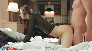 Brunette in black getting fucked on a big bed