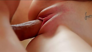 Brown-haired chick gets covered in her BF's jizz